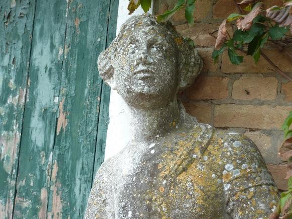 statue against old door in Umbria