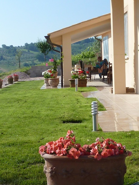 private garden, porch and entrance to Genius Loci Apartment