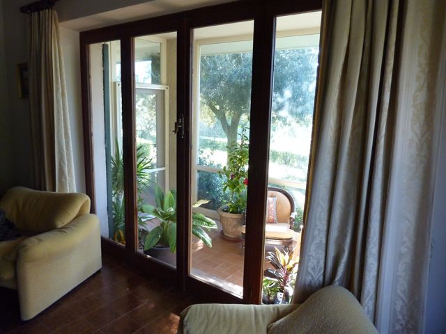 looking out from the front of the living room through the conservatory and onto to the vast view